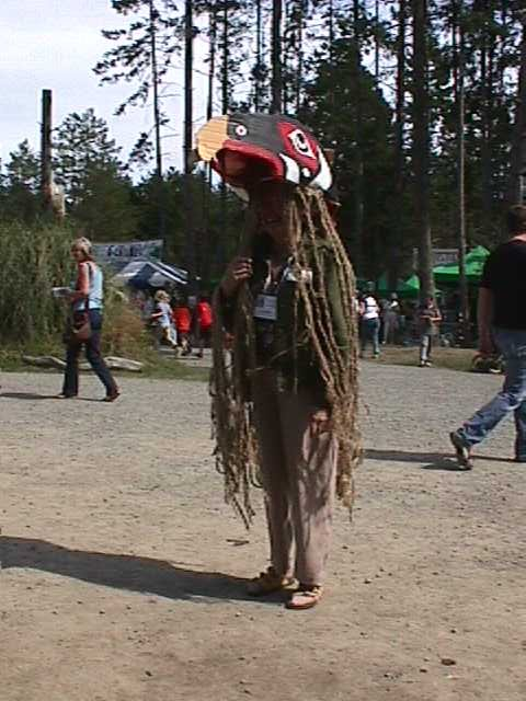 An islander in eagle head-dress.